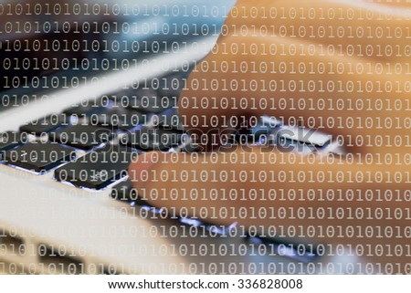 Double exposure of a programmer coding on his laptop dissolved with binary code background