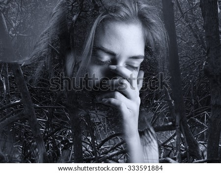 Double Exposure of a young girl crying and dark mangrove forest