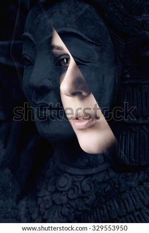 Double Exposure of a young woman in a black dress and a statue of a woman - stock photo