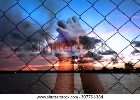 double exposure of asian girl hand hold jail on sunset at the sea background - stock photo