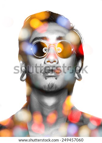 Double exposure of asian guy with glasses and night light