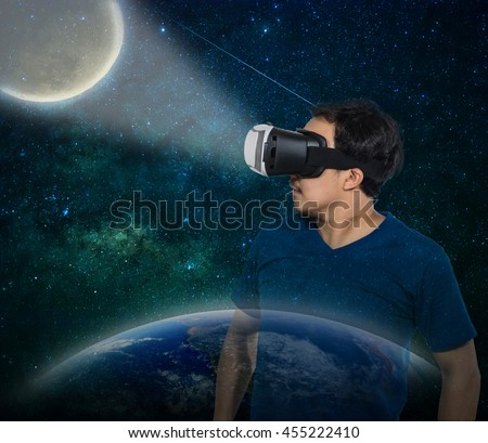 Double exposure of Asian man wearing virtual reality over milky way with the earth and moon background, Elements of this image furnished by NASA, VR concept - stock photo