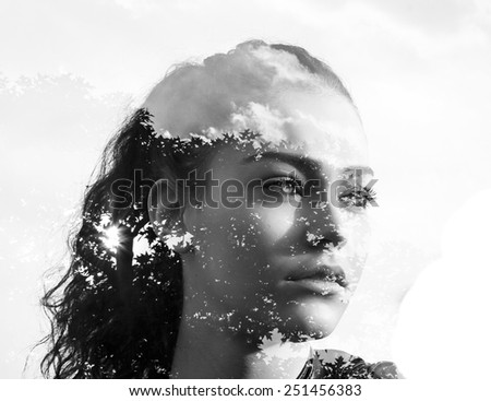 Double exposure of beautiful girl and leaves black and white