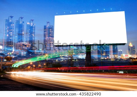 double exposure of blank billboard for advertisement at twilight time with light trails on the road at dusk  - stock photo