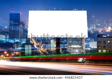 double exposure of blank billboard for advertisement at twilight time with light trails on the road at dusk