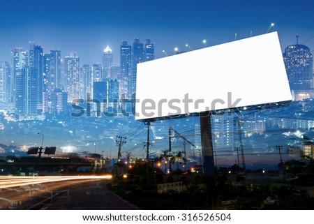 double exposure of blank billboard on city night  - stock photo