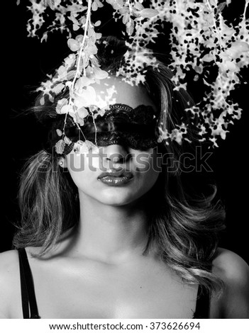 Double exposure of blindfold woman and leaves black and white - stock photo