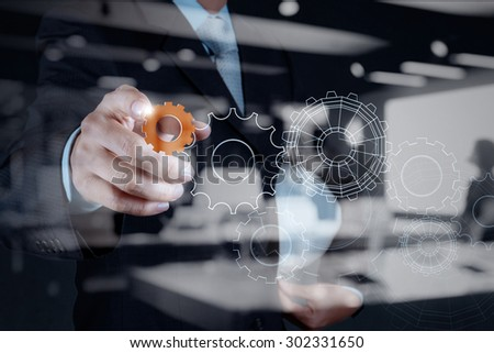 Double exposure of business businessman hand shows gear to success concept - stock photo