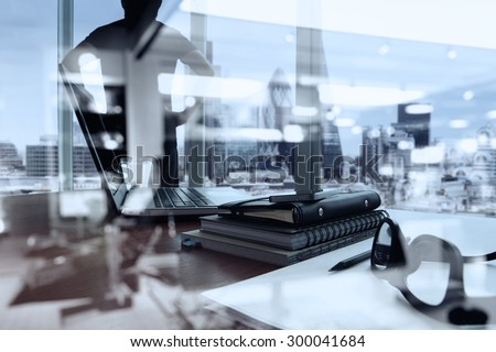 double exposure of business documents on office table with smart phone and digital tablet and london city blurred view and man thinking in the background - stock photo