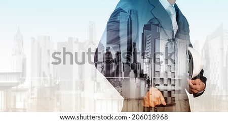 Double exposure of business engineer and abstract city as concept - stock photo