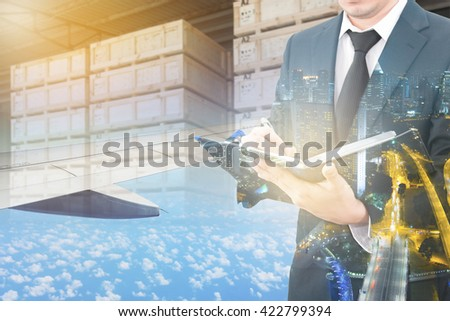 Double exposure of business man analyzing report and business center city with blurred cargo in wooden case at warehouse and export plane aeriel background, exportation and trading concept - stock photo