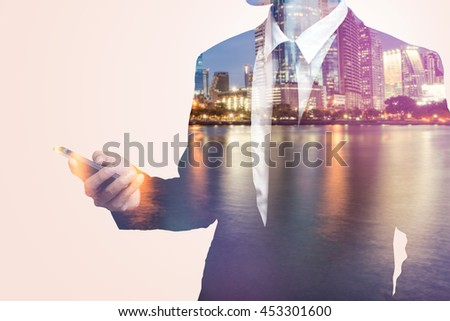 Double exposure of business man and city - stock photo