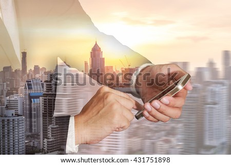 Double exposure of business man hand touch screen smart phone, cellphone, cityscape and sunset as Technology and telecommunication concept. - stock photo