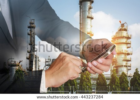 Double exposure of business man hand touch screen smart phone, cellphone,  Electric generating factory and sunset background as Industrial and Technology concept. - stock photo