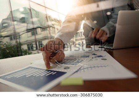 Double exposure of business man hand working on blank screen laptop computer on wooden desk as concept - stock photo