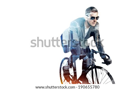 Double exposure of business man on a bicycle and city - stock photo