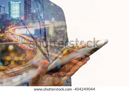 Double exposure of Business Man use Mobile SmartPhone with Urban City Scenic and HighWay as High Speed Internet or Wireless TeleCommunication - stock photo