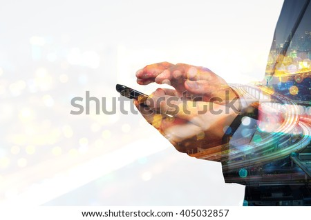 Double exposure of Business Man use Mobile SmartPhone with Urban City Scenic and HighWay as High Speed Internet or Wireless TeleCommunication