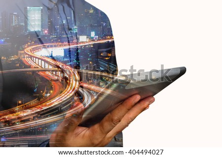 Double exposure of Business Man use Mobile Tablet with Urban City Scenic and HighWay as High Speed Internet or Wireless TeleCommunication