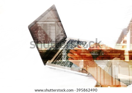Double exposure of Business Man use Notebook with Airport Scene and Flight Schedule as Air Booking or Business Travel concept.
