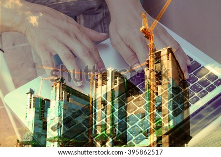 Double exposure of Business Man use Notebook with Construction site and Power Crane for use as Background in Modern Real Estate development concept. Vintage Tone Color Effect used in this image.
