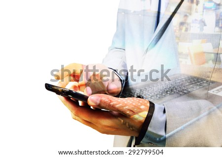 Double exposure of Business Man using Mobile Phone with Notebook or laptop computer as Wireless Technology concept. - stock photo