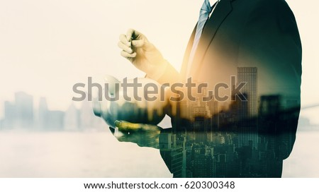 Double exposure of business man with piggy bank and city background