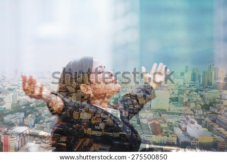 Double exposure of business woman with her hands up. - stock photo
