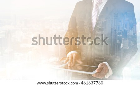 Double Exposure of Businessman abstract background and city