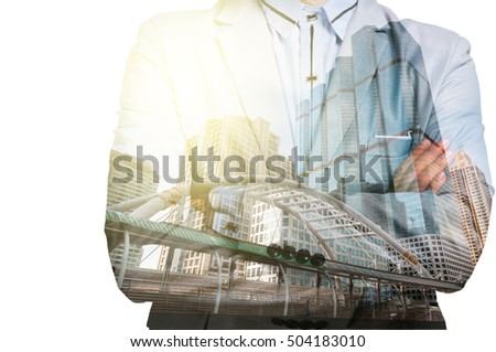 Double Exposure of Businessman and Business building City at Sunrise as Business Concept