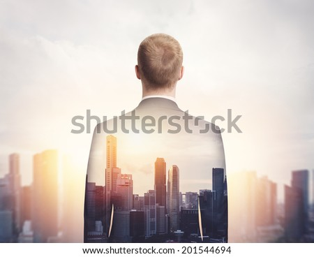 double exposure of businessman and megalopolis - stock photo
