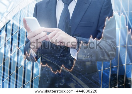 Double exposure of businessman connect internet smart phone , server storage computer and city of business with world financial graph, Business, finance, trading & banking concept - stock photo