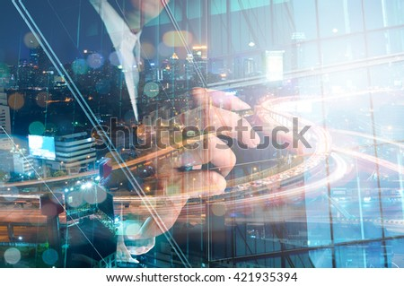 Double Exposure of Businessman draw Something with City Traffic Scene at Night and Glass decorated Building - stock photo
