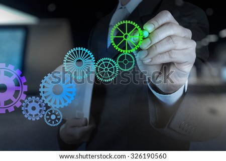 Double exposure of businessman hand draw leader cog gear to success concept - stock photo
