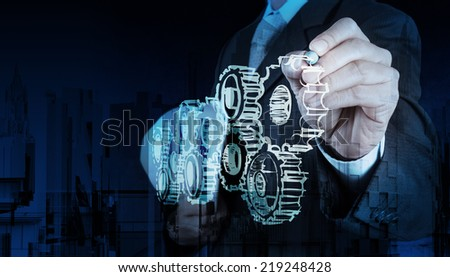 Double exposure of businessman hand draws gear to success concept  - stock photo