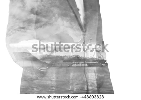 Double exposure of businessman hand hold tablet, cargo port ship at sea port concept - stock photo