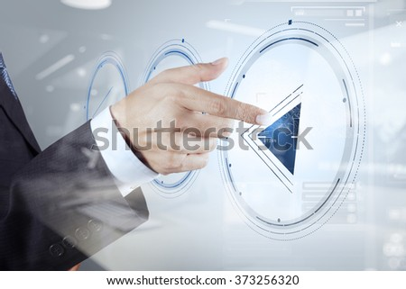 double exposure of businessman hand press play button sign to start or initiate projects as concept  - stock photo