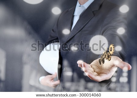 double exposure of businessman hand showing gear to success concept - stock photo