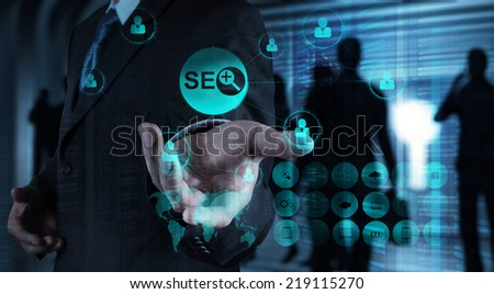 Double exposure of businessman hand showing search engine optimization SEO as concept  - stock photo