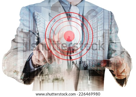 Double exposure of businessman hand shows target symbol as business concept
