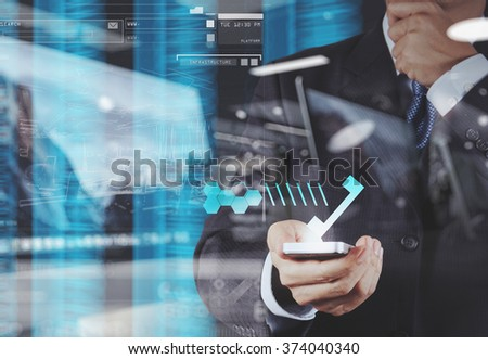 double exposure of businessman hand using the phone tablet touch computer gadget as concept  - stock photo