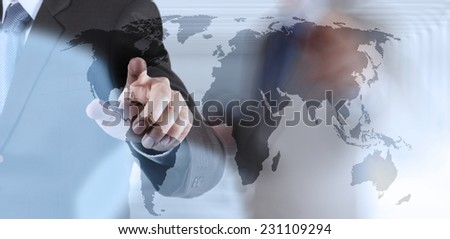 Double exposure of businessman hand working on world map on touch screen computer as concept