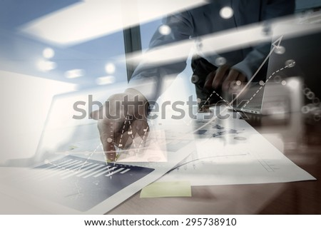 double exposure of businessman hand working with business documents on office table with laptop computer with social media diagram with graph chart - stock photo