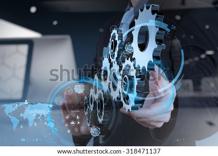 double exposure of businessman hand working with cog gear to success as concept