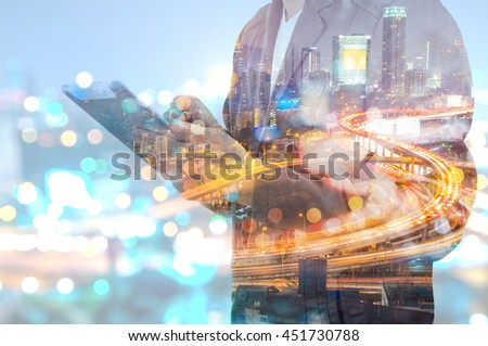 Double Exposure of BusinessMan hold Digital Tablet with Modern City Building and Highway as Digital Technology concept - stock photo