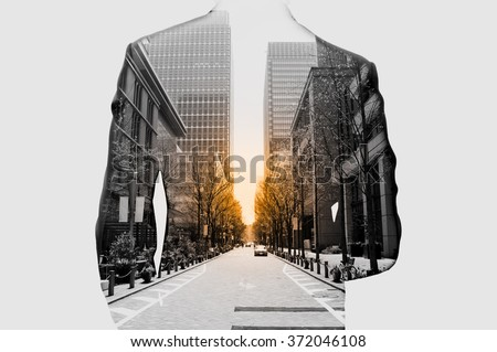 Double exposure of businessman in suit and cityscape. He's looking for his success in business and idea for life - stock photo