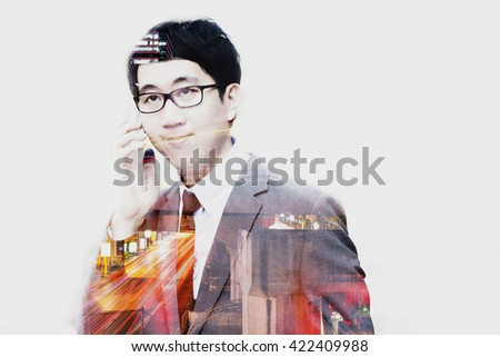 Double exposure of businessman talking on the phone with cityscape scene. - stock photo