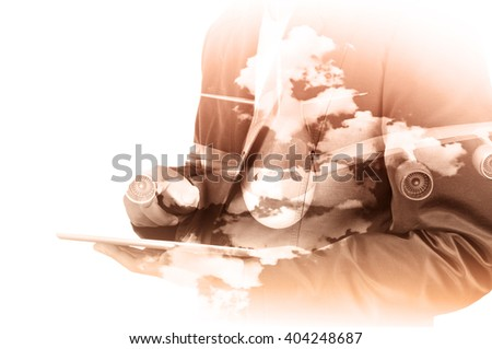 Double Exposure of Businessman use Computer Tablet with Airplane and Cloud Sky as Transportation Business Concept