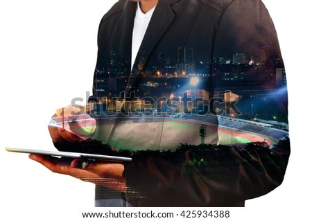 Double exposure of Businessman use Digital Tablet with Sport Stadium at Night