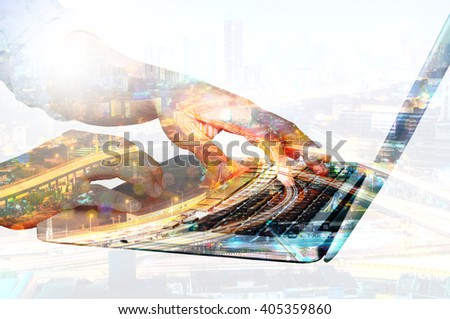 Double exposure of Businessman use Notebook Computer with City Office Building